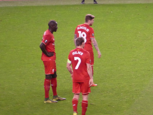 James Milner with Moreno & Sakho