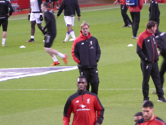 Jurgen Klopp watches over Christian Benteke in training